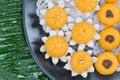Kanom jamongkut kanom thong ek and kanom sanay chan gold thai dessert on banana leaf Stock Photo