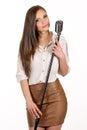 Karaoke girl singing isolated on white background lovely Royalty Free Stock Photo
