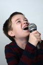 Karaoke happy boy singing a song Royalty Free Stock Photo