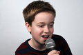 Karaoke happy boy singing a song Stock Photography