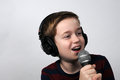 Karaoke happy boy singing a song Royalty Free Stock Photography