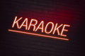 Karaoke neon sign for club on wall Royalty Free Stock Images