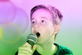 Karaoke portrait of a boy singing Stock Image