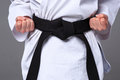 The karate girl with black belt Royalty Free Stock Photo