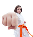 Karate girl with her fist in foreground Royalty Free Stock Image