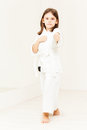Karate girl wearing kimono standing in stance Royalty Free Stock Photo