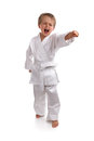 Karate kid young boy in a suit doing martial arts moves Royalty Free Stock Images