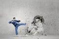 Karate man attack dollar Royalty Free Stock Photo