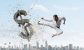 Karate man attack dollar Royalty Free Stock Photo