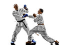 Karate men teenager student fighters fighting protections two sensei and isolated on white background Stock Image