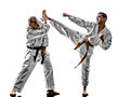 Karate men teenager student fighters fighting two sensei and isolated on white background Stock Images