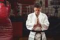 Karate player in prayer pose Royalty Free Stock Photo