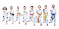 In karategi eight athletes are beating punch gyaku-tsuki Royalty Free Stock Photo