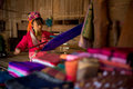 Karen long necked tribe woman weaves on a loom in hills near Chiang Mai, Thailand Royalty Free Stock Photo