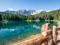 Karerlake in italy at the background the dolomites Stock Photos