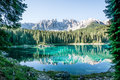 Karerlake in italy at the background the dolomites Royalty Free Stock Photos