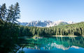 Karerlake in italy at the background the dolomites Royalty Free Stock Photography