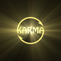 Karma letter Buddhism sign light flare Royalty Free Stock Photo