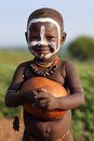 Karo boy with face painting cute little and calabash at a ceremony in south omo ethiopia Royalty Free Stock Photo