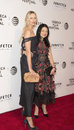 Karolina kurkova stunning supermodel and designer vivienne tam russian joins on the red carpet for opening night at the tribeca Royalty Free Stock Photography