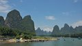 Karsts hillsides along li river guilin is famous for its unusual karst topography visitors cruised the to see the scenery Royalty Free Stock Photo