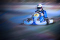 Karting - driver in helmet on kart circuit Royalty Free Stock Photo