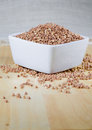 Kasha buckwheat groats in a ceramic bowl raw known as Stock Photo