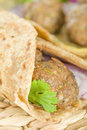 Kati roll kofta kebabs and red onion pickle rolled in a paratha fried with eggs indian street food Royalty Free Stock Photo