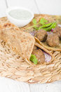 Kati roll kofta kebabs and red onion pickle rolled in a paratha fried with eggs indian street food Royalty Free Stock Images
