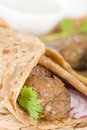 Kati roll kofta kebabs and red onion pickle rolled in a paratha fried with eggs indian street food Royalty Free Stock Image