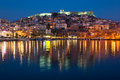 Kavala town at night greek of with reflection of street and house lights in the sea Royalty Free Stock Photos
