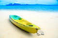 Kayak on the beach with background of blue tropical sea Royalty Free Stock Photos