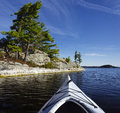 Kayak northern lake pine trees island Royalty Free Stock Photo