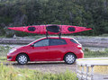 Kayak over small car travelling Stock Images