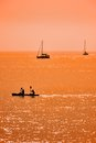 Kayak and sailboats Royalty Free Stock Photo