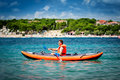 Kayak on the sea young man paddle a Royalty Free Stock Image