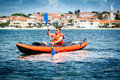 Kayak on the sea young man paddle a Royalty Free Stock Photos
