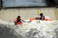 Kayak training two people in kayaks train at the east race water course in south bend indiana this was the first man made course Stock Photo