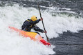 Kayaker an active male rolling and surfing in rough water Royalty Free Stock Photo