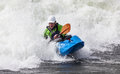 Kayaker an active male rolling and surfing in rough water Royalty Free Stock Image