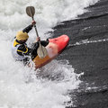 Kayaker an active male rolling and surfing in rough water Royalty Free Stock Photography