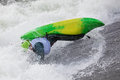 Kayaker an active male rolling and surfing in rough water Stock Photography