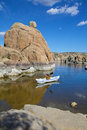 Kayaker on watson lake kayaking scenic near prescott arizona with interesting granite rock formations Stock Photos