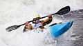 Kayaking an active male kayaker rolling and surfing in rough water Royalty Free Stock Photo