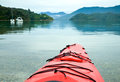 Kayaking in new zealand red touring kayak waters of the marlborough sounds Royalty Free Stock Photo
