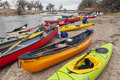 Kayaks and canoes south platte river evans colorado april on a river shore below diversion dam during annual all club paddle on Royalty Free Stock Images
