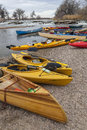 Kayaks and canoes south platte river evans colorado april on a river shore below diversion dam during annual all club paddle on Stock Image