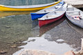 Kayaks colorful beached on the edge of the moraine lake Royalty Free Stock Photo