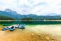 Kayaks docked on the shore of Black Lake. Mountain landscape, Durmitor National Park, Zabljak, Montenegro. Royalty Free Stock Photo