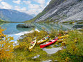 Kayaks at glacier lake autumn colorful the glacial in Stock Image